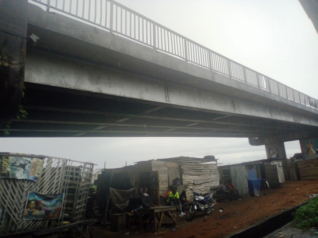 Makeshift shanties of people hustling under the Udu bridge Credit: BIGPEN PHOTO